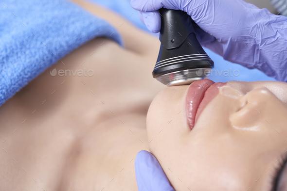 Closeup of contemporary spa salon face treatment - Stock Photo - Images