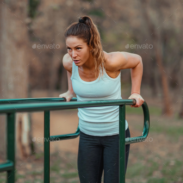 Exercising on Parallel Bar, Outdoor Gym - Stock Photo - Images