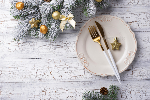 Christmas table setting and golden decor - Stock Photo - Images