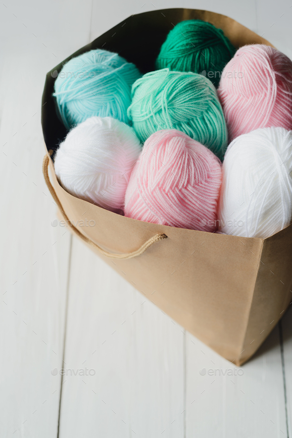 oval acrylic wool yarn thread skeins with kraft package - Stock Photo - Images