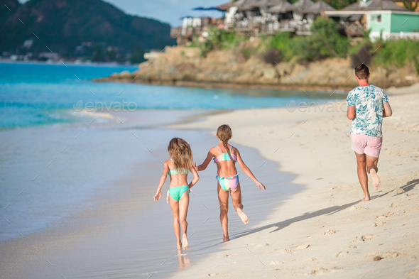 Portrait of family in summer on the seashore - Stock Photo - Images