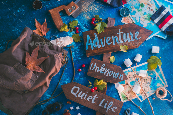 Road sign with Adventure, Unknown and Quiet Life directions. Travel essentials creative header - Stock Photo - Images