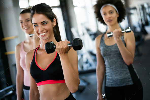 Diversity group of people training in a gym. Trainer and sportive persons exercising - Stock Photo - Images