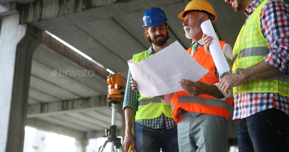 Engineer, contractor, architect teamwork. Construction people talking and planning work, blueprint - Stock Photo - Images