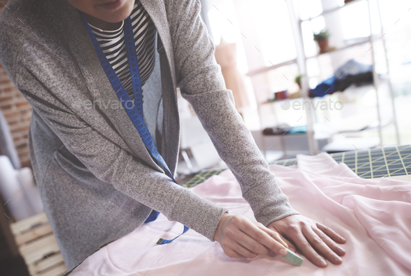Creative fashion designer chalking outline - Stock Photo - Images