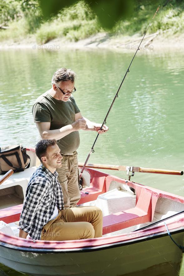 Men make preparations for fishing - Stock Photo - Images