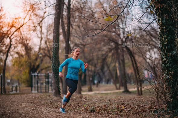 Attractive Woman Jogging. Nature, Outdoors - Stock Photo - Images