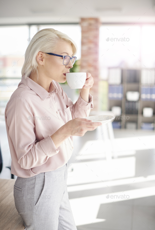 Employee having a coffee at work - Stock Photo - Images
