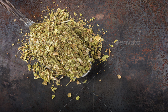 Spoon filled with dried oregano - Stock Photo - Images