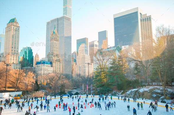 Ice skaters having fun in New York Central Park in winter - Stock Photo - Images