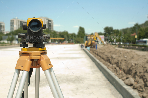 Surveying equipment to infrastructure construction project - Stock Photo - Images
