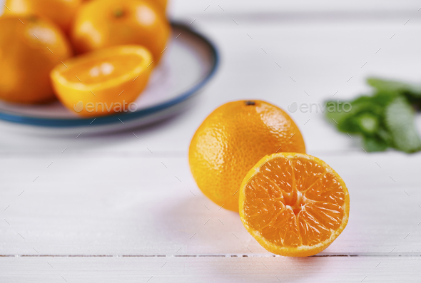 Whole and half of tangerine - Stock Photo - Images