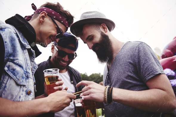 Men talking at the summer festival - Stock Photo - Images