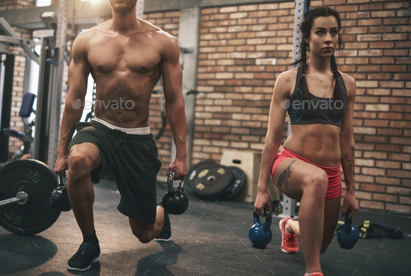 Young couple working out with kettlebells - Stock Photo - Images