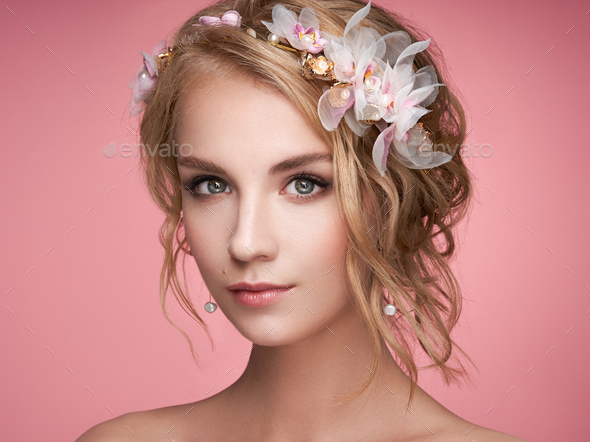 Young blonde woman with tiara on her head - Stock Photo - Images