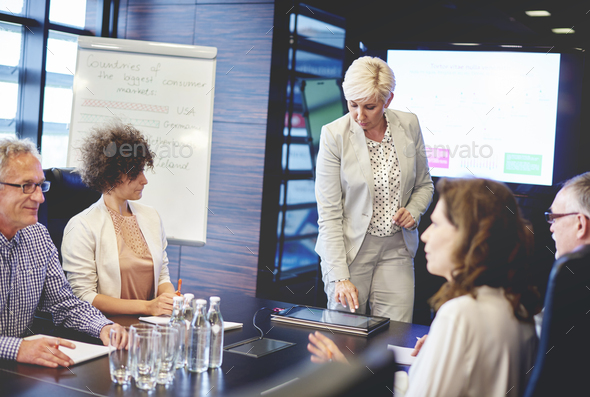 Mature woman doing presentation with digital tablet - Stock Photo - Images