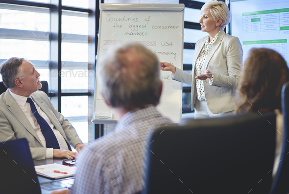 Business woman guiding in business meeting - Stock Photo - Images