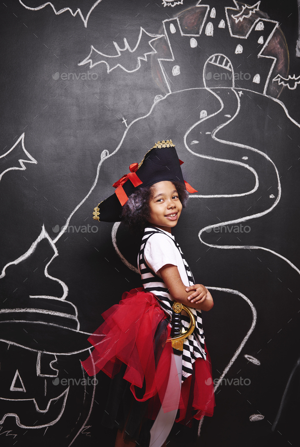 Mixed race girl in pirate costume - Stock Photo - Images