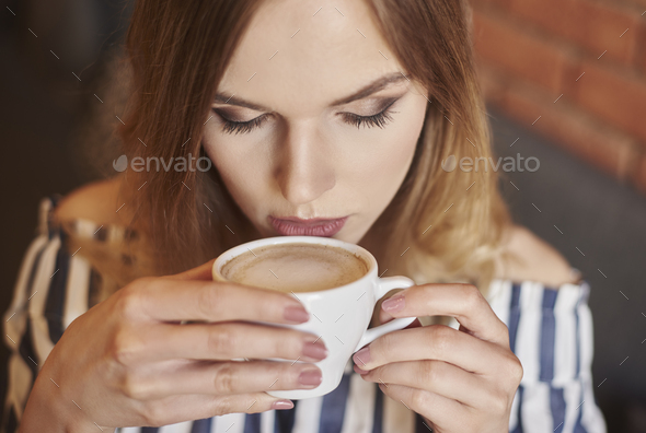 Headshot of woman drinking coffee - Stock Photo - Images