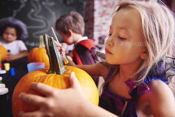 Kids preparing a pumpkins for halloween - Stock Photo - Images