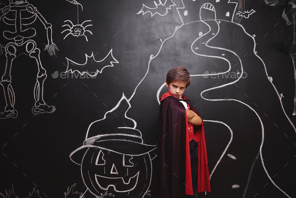 Boy in vampire costume posing - Stock Photo - Images