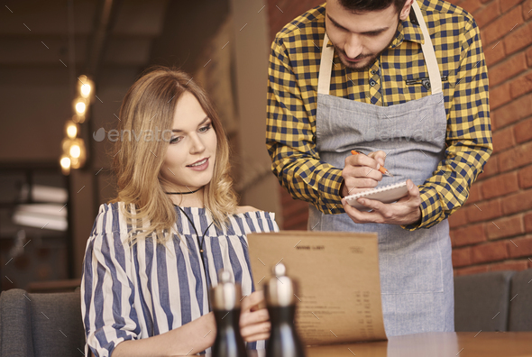 Young woman placing an order - Stock Photo - Images