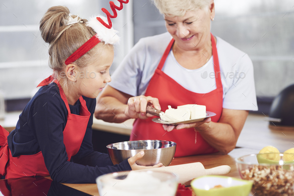 Grandmother and granddaughter cooking in the kitchen - Stock Photo - Images