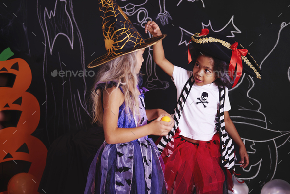 Two girls spending time together at halloween party - Stock Photo - Images