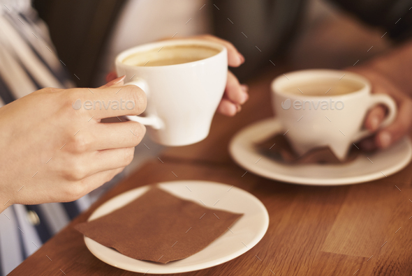 People in cafe having coffee break - Stock Photo - Images