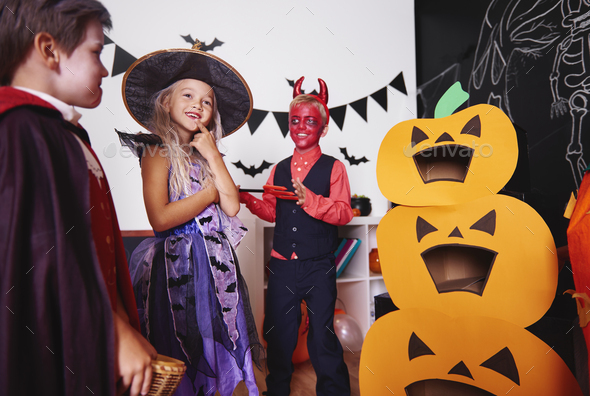 Children in halloween costumes at traditional festival - Stock Photo - Images