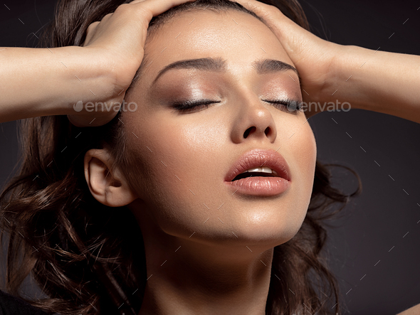 Beautiful woman with brown hair. Attractive model with brown eye - Stock Photo - Images