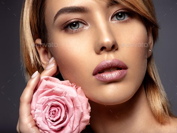 Beautiful young fashion woman with light pink lipstick. Beauty m - Stock Photo - Images