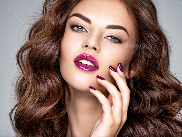 Beautiful and stunning woman with  purple lipstick on lips and f - Stock Photo - Images