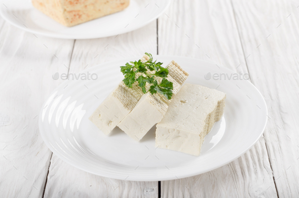 Soy Bean curd tofu on clay dish closeup. Non-dairy alternative s - Stock Photo - Images