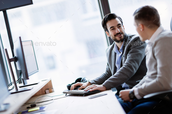 Picture of businesspeople working on computer together - Stock Photo - Images