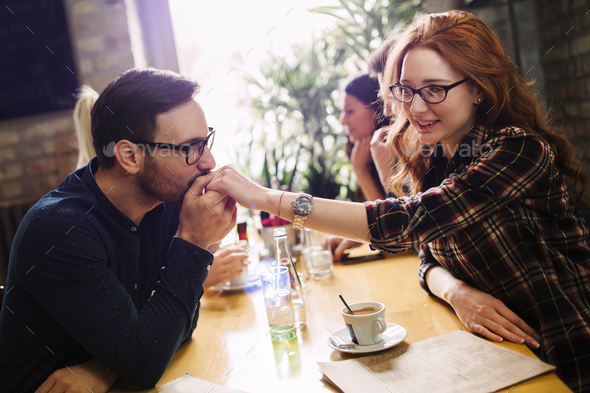 Handsome man flirting with cute woman in restaurant - Stock Photo - Images