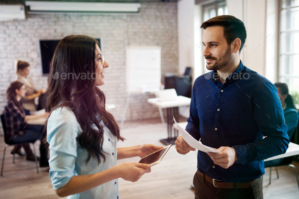 Picture of young designers discussing in office - Stock Photo - Images