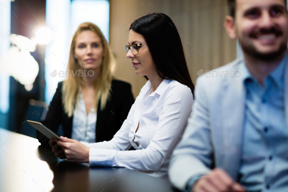 Young attractive businesswoman using tablet on meeting - Stock Photo - Images