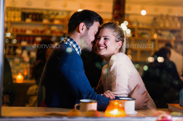 Young attractive couple on date in bar - Stock Photo - Images