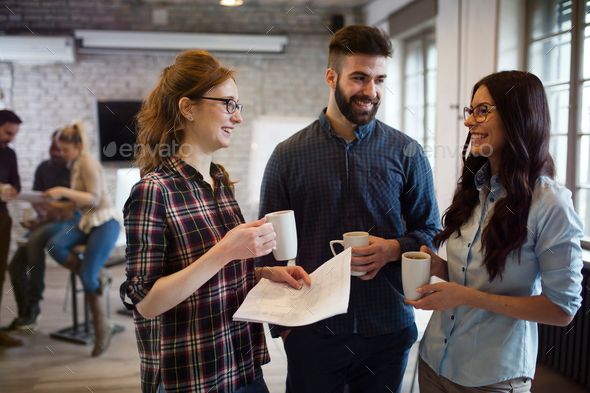 Picture of group of young perspective designers discussing - Stock Photo - Images