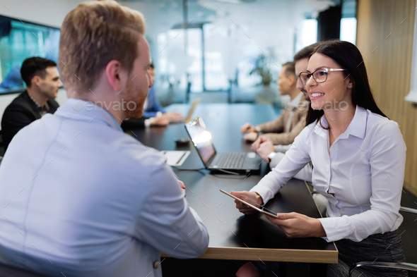 Portrait of business couple in conference room - Stock Photo - Images
