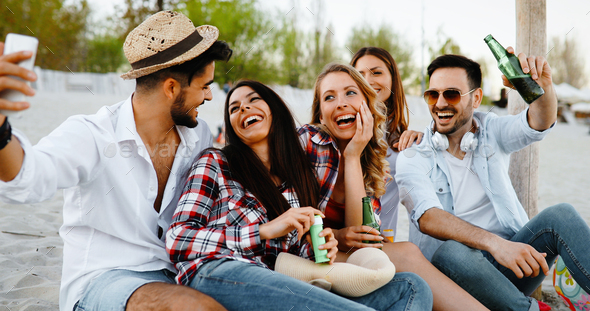 Happy group of young people having fun on beach - Stock Photo - Images