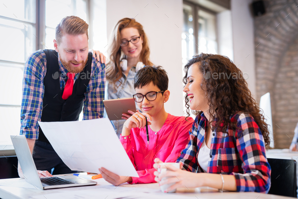 Business coworkers celebrate achieved goals in office - Stock Photo - Images