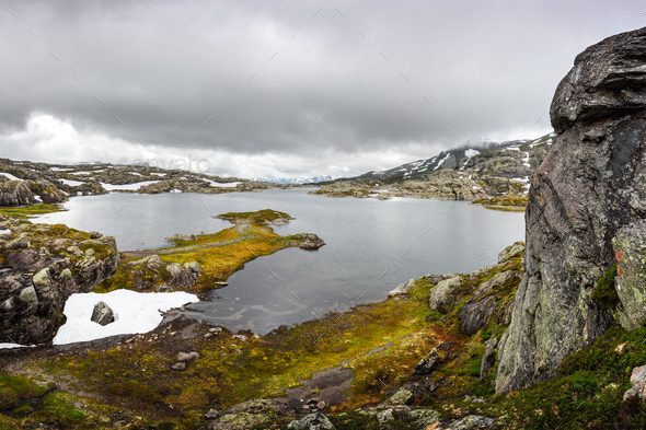 Amazing norwegian landscape with snowy mountains - Stock Photo - Images
