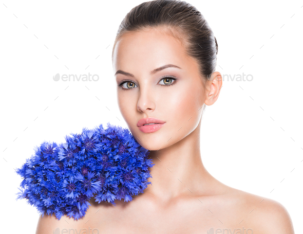 Face of a beautiful girl  with blue posy fild flowers. - Stock Photo - Images