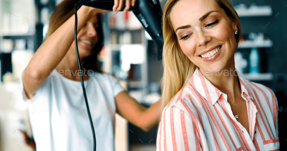Portrait of a woman at the hair salon - Stock Photo - Images