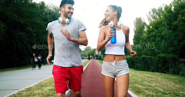 Beautiful couple jogging in nature - Stock Photo - Images