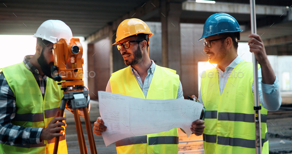 Team of architects people in group on construciton site - Stock Photo - Images