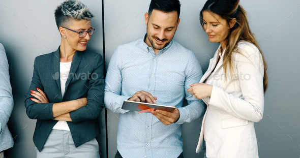 Business colleagues having conversation during coffee break - Stock Photo - Images