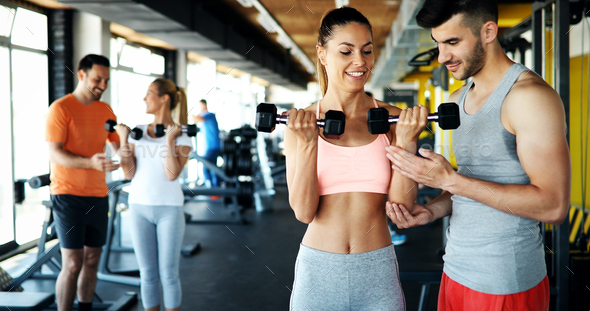 Group of friends exercising together in gym - Stock Photo - Images